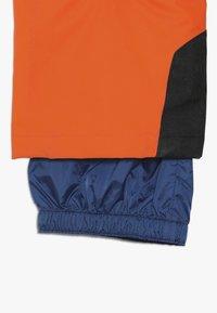 Ziener - ANDO JUNIOR - Snow pants - bright orange - 3