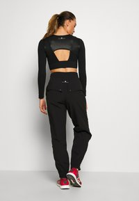 adidas by Stella McCartney - Outdoor trousers - black - 2