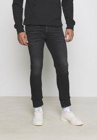 American Eagle - Slim fit jeans - washed black - 0