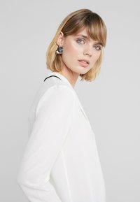 HUGO - EMOLA - Button-down blouse - natural - 4