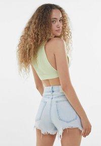 Bershka - MIT AUSGEFRANSTEM SAUM  - A-line skirt - light blue - 2