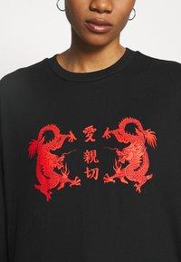 Merchcode - LADIES CHINESE LETTERS LONGSLEEVE - Long sleeved top - black - 4