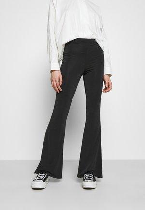 SLINKY  - Trousers - black