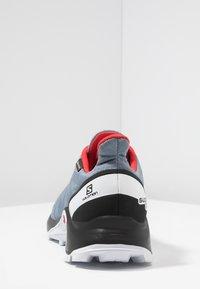 Salomon - SUPERCROSS GTX - Trail running shoes - flint stone/black/high risk red - 3