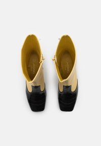 Monki - KEELY BOOT VEGAN - Classic ankle boots - yellow/black - 5