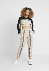 adidas Originals - TRACK PANTS - Trousers - ash pearl - 1
