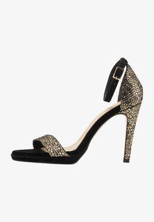 High heeled sandals - gold black