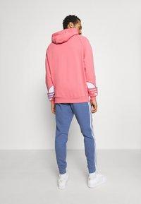 adidas Originals - STRIPES PANT - Tracksuit bottoms - crew blue - 2