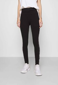 Hollister Co. - HOLIDAY GRAPHIC  - Leggings - Trousers - black side tape - 0