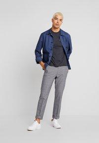 Calvin Klein Jeans - CORE EMBRO TEE - Jednoduché triko - black - 1