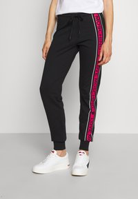 Love Moschino - Tracksuit bottoms - black - 0