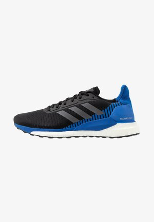 SOLAR GLIDE ST 19 - Stabilty running shoes - core black/grey five/blue