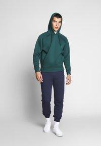 Lacoste LIVE - Teplákové kalhoty - navy blue - 1