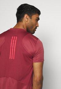 adidas Performance - HEAT.RDY TRAINING SLIM SHORT SLEEVE TEE - Print T-shirt - legend red - 4