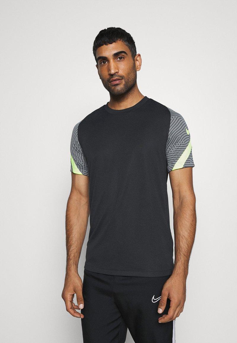Nike Performance - DRY STRIKE - Print T-shirt - black/smoke grey/black/volt