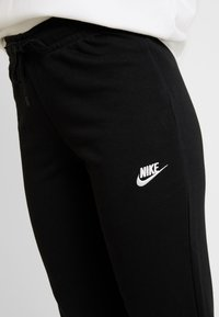 Nike Sportswear - TIGHT - Pantaloni sportivi - black/white - 4