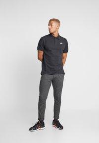 Nike Sportswear - M NSW CE POLO MATCHUP PQ - Polotričko - black - 1