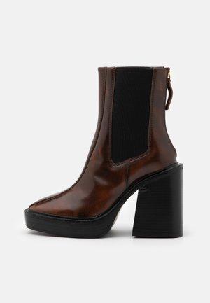 HONG KONG CASUAL PLATFORM - Platform ankle boots - tan