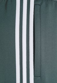 adidas Originals - UNISEX - Tracksuit bottoms - blue oxide - 2