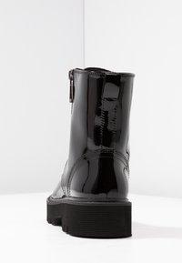 Calvin Klein Jeans - DIAHNE - Platform ankle boots - black - 5