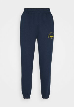 CLUB EST UNISEX - Tracksuit bottoms - blue