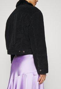 Levi's® - NEW HERITAGE TRUCKR - Winter jacket - black - 3