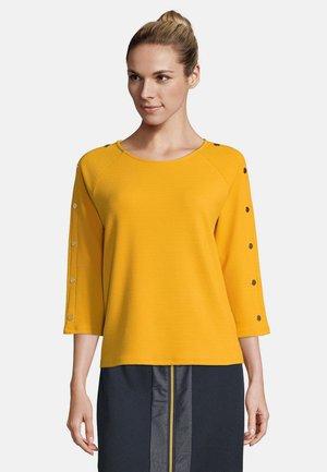 MIT KNOPFLEISTE - Sweatshirt - golden glow