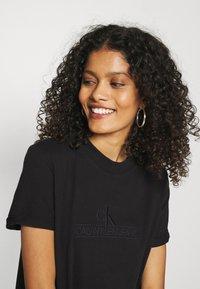 Calvin Klein Jeans - ARCHIVES DYE DRESS - Vestido ligero - black - 3