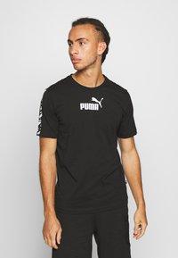 Puma - AMPLIFIED TEE - T-shirt imprimé - black - 0