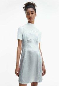 Calvin Klein Jeans - METALLIC SATIN SLIP - Cocktail dress / Party dress - silver - 0