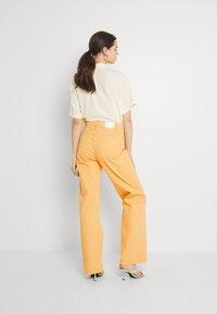Monki - Straight leg jeans - mango yellow - 2