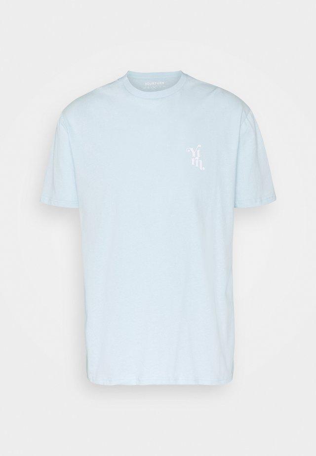UNISEX - T-shirt med print - light blue