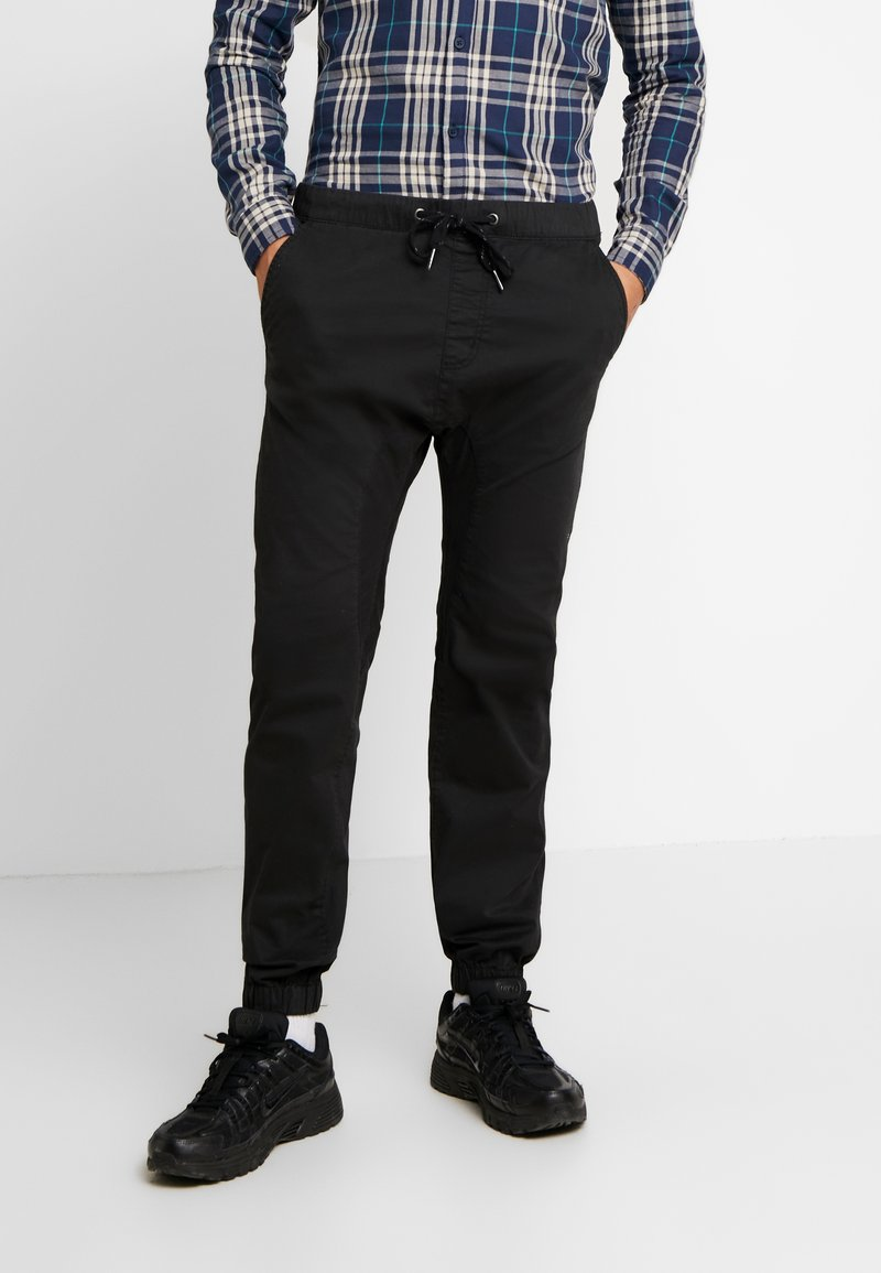 Cotton On - DRAKE CUFFED PANT - Stoffhose - true black