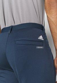 adidas Golf - PRIMEBLUE JOGGER - Pantalones - navy/white - 4