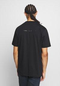 Diesel - T-JUST-SLITS-X83 T-SHIRT - Print T-shirt - black - 2
