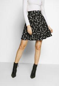 NAF NAF - KATHIOCHAINE - Mini skirts  - noir/ecru - 0