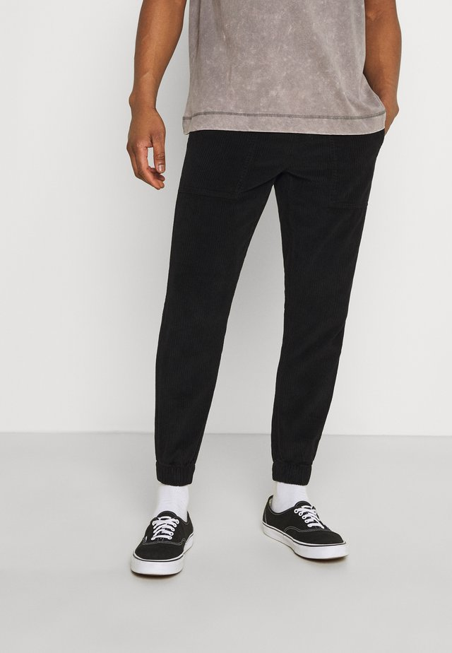 JAZZ PANTS - Trousers - black