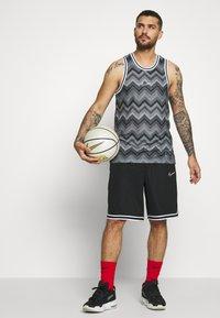 Nike Performance - CITY EXPLORATION DRY HOOP X FLY - Sports shirt - black/university red/white - 1