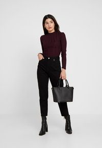 Dr.Denim Petite - NORA - Relaxed fit jeans - black - 1