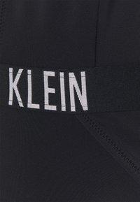 Calvin Klein Swimwear - INTENSE POWER PLUNGE ONE PIECE - Swimsuit - black - 6