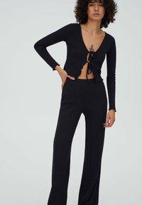 PULL&BEAR - GERIPPTE - Trousers - black - 3