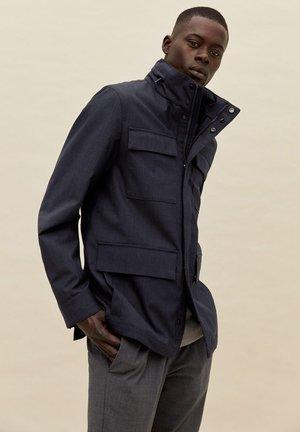 GRAVITY - Waterproof jacket - gris chiné foncé