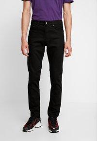 Nudie Jeans - STEADY EDDIE - Straight leg jeans - dry ever black - 0