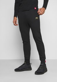 Alpha Industries - BASIC JOGGER FOIL - Tracksuit bottoms - black/yellow gold - 0