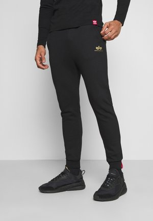 BASIC JOGGER FOIL - Tracksuit bottoms - black/yellow gold