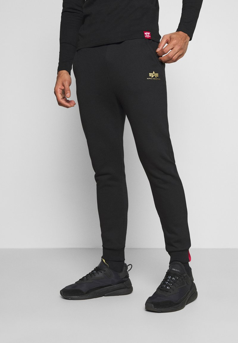 Alpha Industries - BASIC JOGGER FOIL - Tracksuit bottoms - black/yellow gold