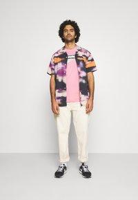 Nike Sportswear - TEE BRANDMARK - Print T-shirt - light arctic pink - 1