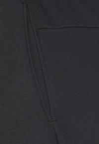 Nike Performance - TAPER - Tracksuit bottoms - black/white - 6