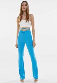 Bershka - Trousers - blue - 1