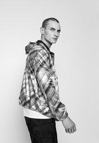 Emporio Armani - BLOUSON JACKET - Waterproof jacket - grey - 4